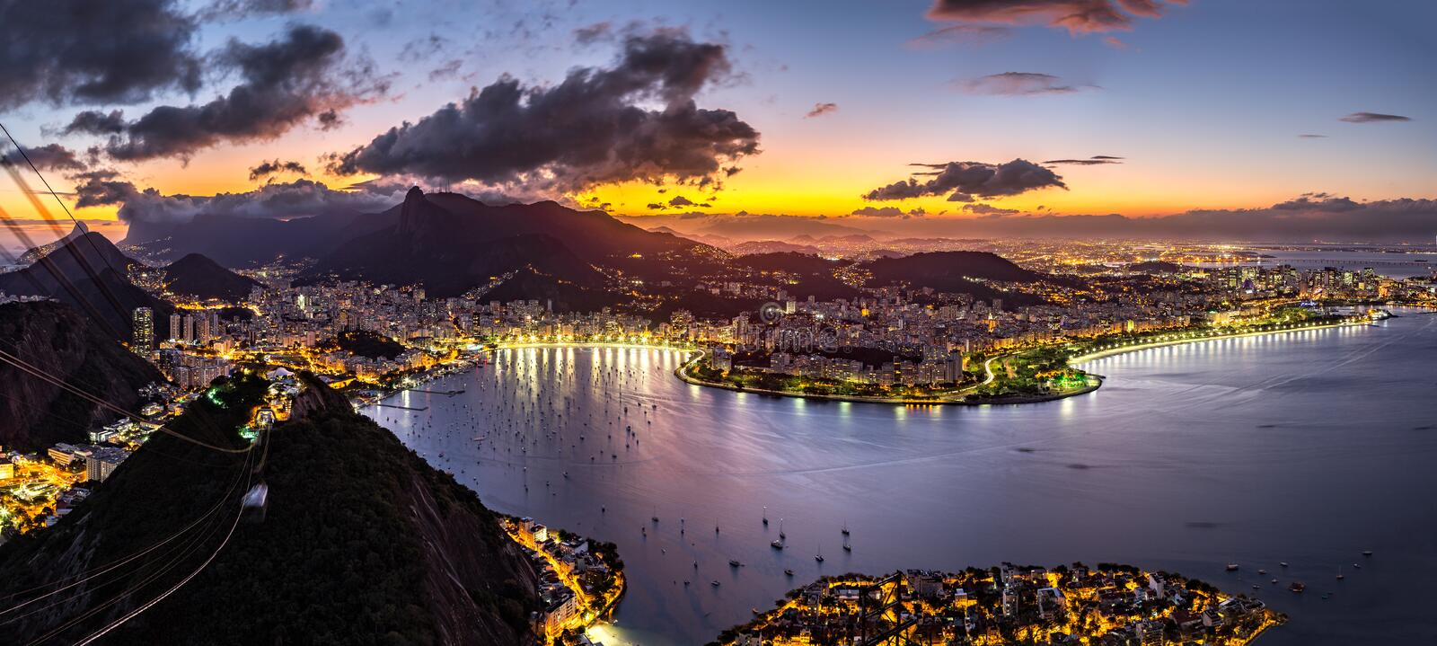 Panoramic view of Rio de Janeiro by night. Panoramic view of Rio de Janeiro on a hazy night, as viewed from Sugar Loaf peak royalty free stock photos