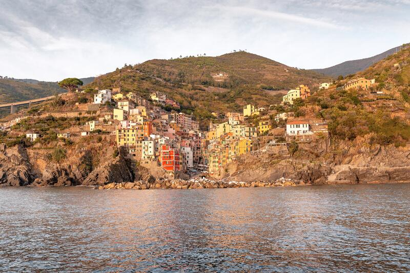 View of Riomaggiore fishing town in Cinque terre nature park. Travel and vacation destination in Italy and Europe. Panoramic view of Riomaggiore fishing town in stock photography