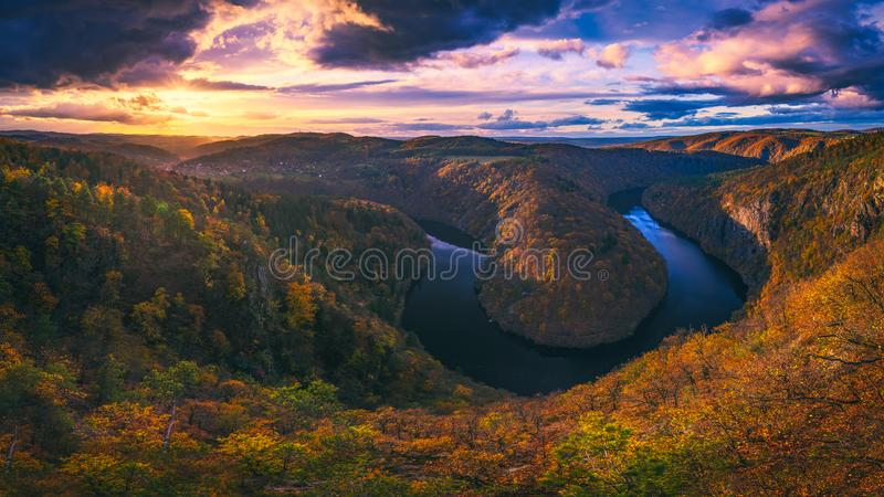 Panoramic view of river canyon with dark water and autumn colorful forest. Horseshoe bend, Vltava river, Czech republic. Beautiful landscape with river. Maj stock image