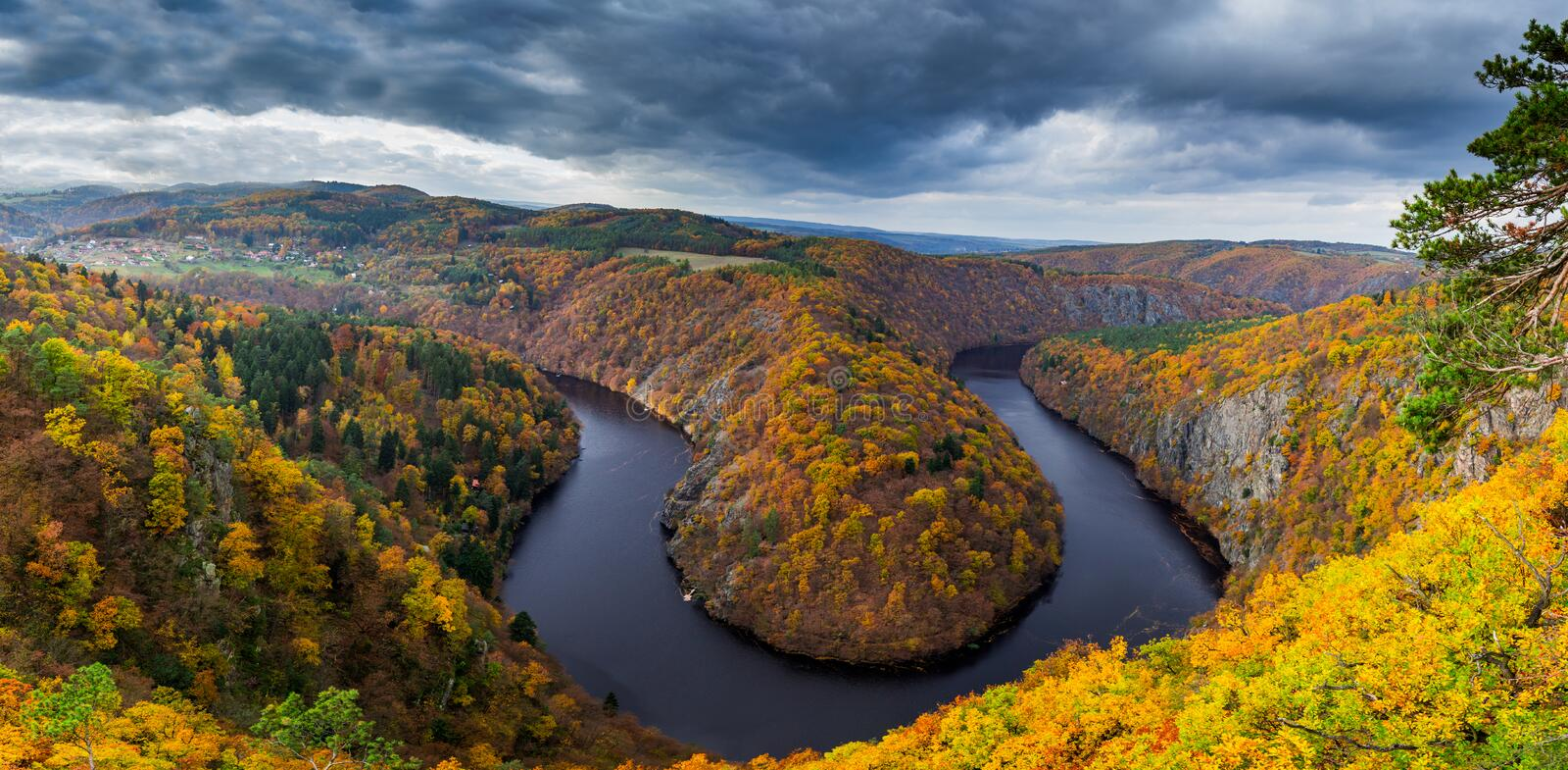 Panoramic view of river canyon with dark water and autumn colorful forest. Horseshoe bend, Vltava river, Czech republic. Beautiful. Landscape with river. Maj stock image
