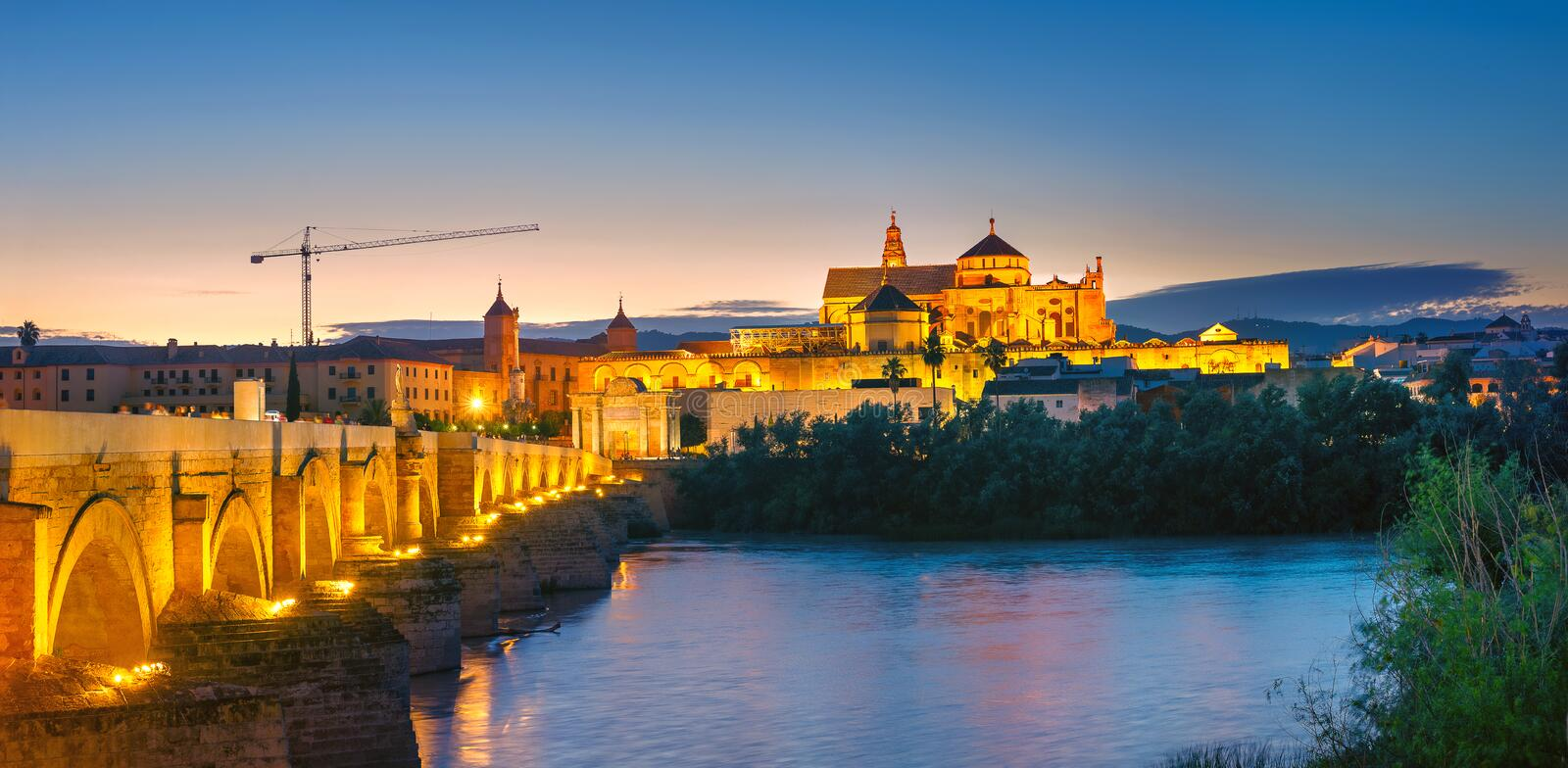 Night landscape with Roman Bridge and Great Mosque Mezquita cathedral, Cordoba, Andalusia, Spain stock photography