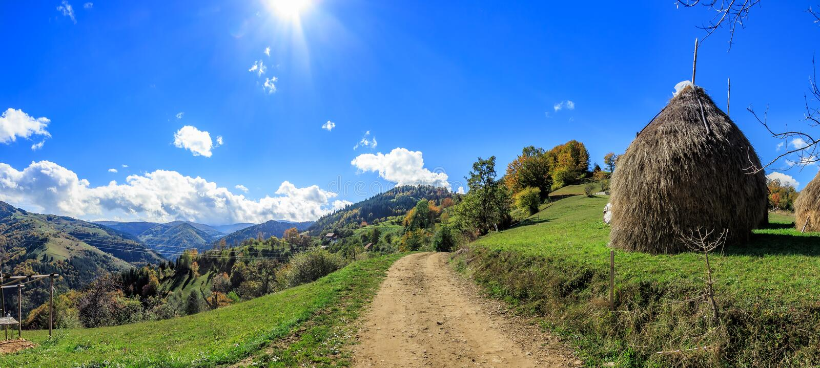 Panoramic view of rural mountain village road in autumn stock photography