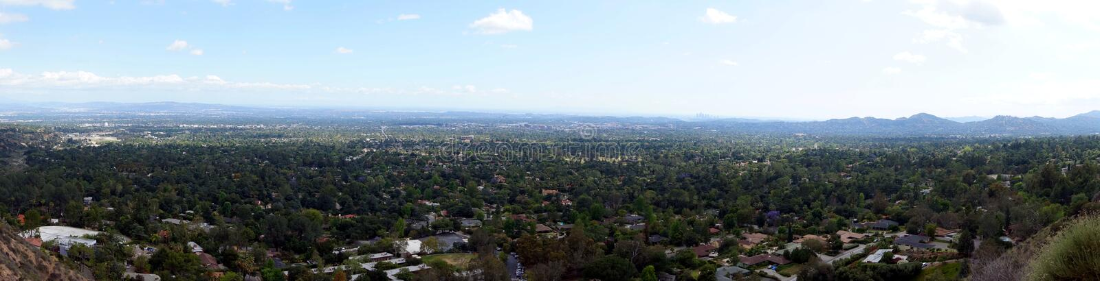 Panoramic view of Los Angeles from Altadena mountains. Panoramic view. Los Angeles, Altadena, Pasadena. Downtown Los Angeles is hardly visible through the fog stock photos