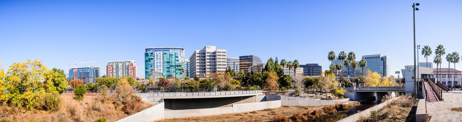 Panoramic view of San Jose`s downtown skyline as seen from the s. Horeline of Guadalupe river on a sunny fall day; Silicon Valley, California royalty free stock photos