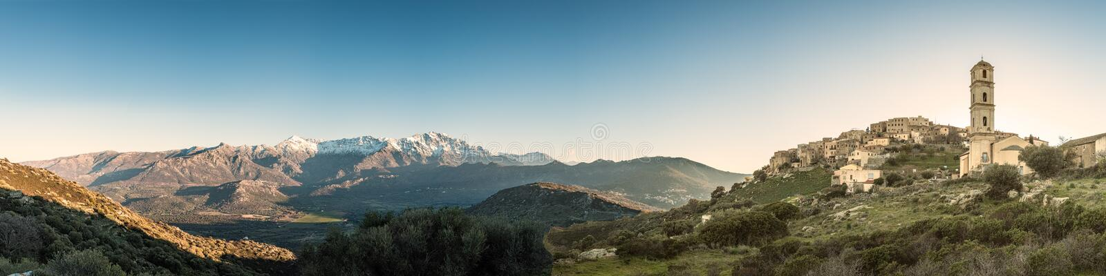 Panoramic view of Sant` Antonino and snow capped mountains in Co stock image
