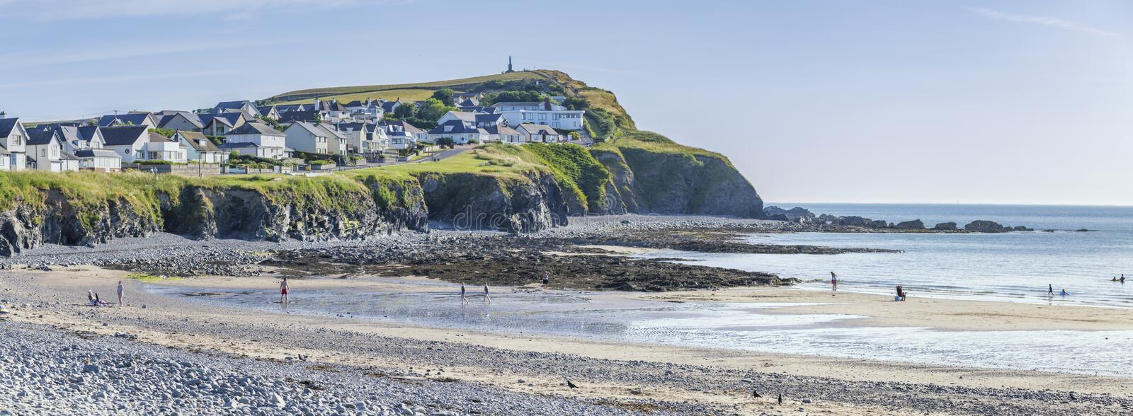 Panoramic View of Scenic Beach in Wales, UK. Panoramic view over scenic  beach at low tide on bright summer day in Borth, Wales in United Kingdom royalty free stock images