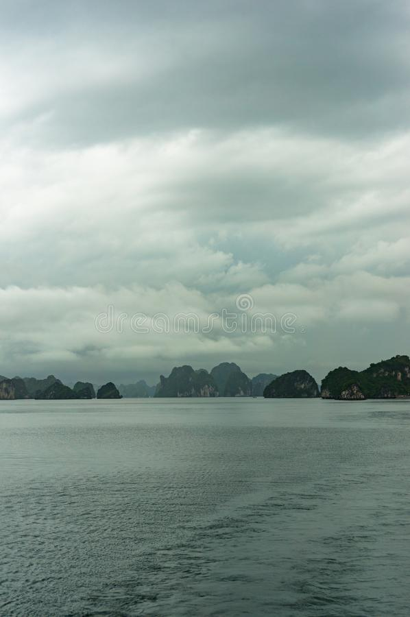 Panoramic view on scenic karst islands of Halong Bay on storm stock photography