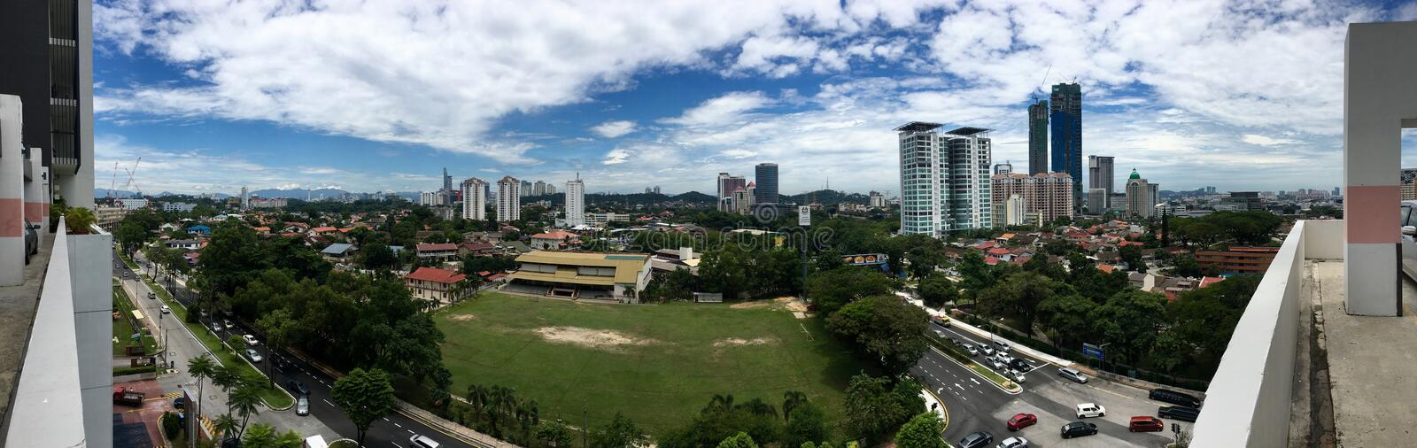 Panoramic view of School Field and surrounding in Petaling Jaya. Selangor, Malaysia Section 14 with school building, condominium, housing area and skyscraper stock photography