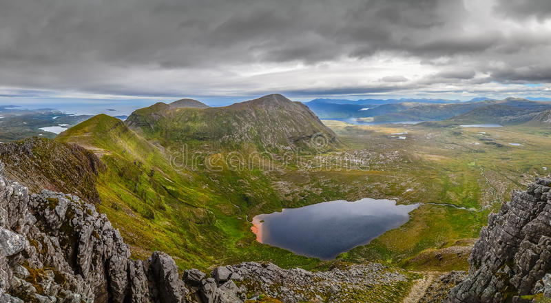 Panoramic view of Scottish highlands, mountains in Loch Assynt. Area, United Kingdom royalty free stock photography