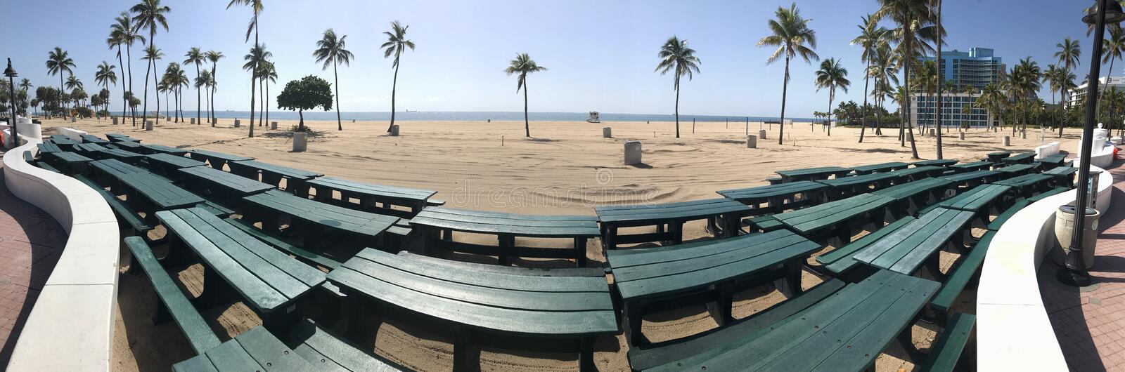 Panoramic View Shows Stacked Picnic Tables And Empty Florida Beach royalty free stock photo