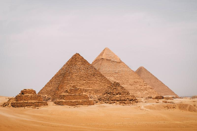 Panoramic view of the six great pyramids of Egypt. Pyramid of Khafre, pyramid of Khufu, and the red pyramid. royalty free stock photos