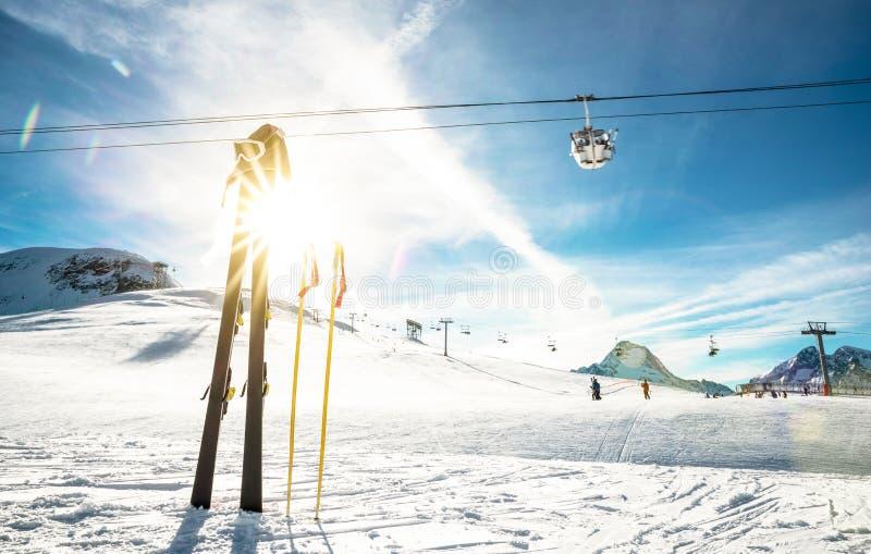 Panoramic view of ski resort and chair lift in french alps. Panoramic view of ski resort glacier and chair lift in french alps - Winter vacation and travel stock photo