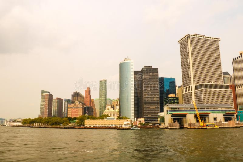 Panoramic view of skyline of downtown Manhattan over Hudson River under blue sky, in New York City, USA stock photo
