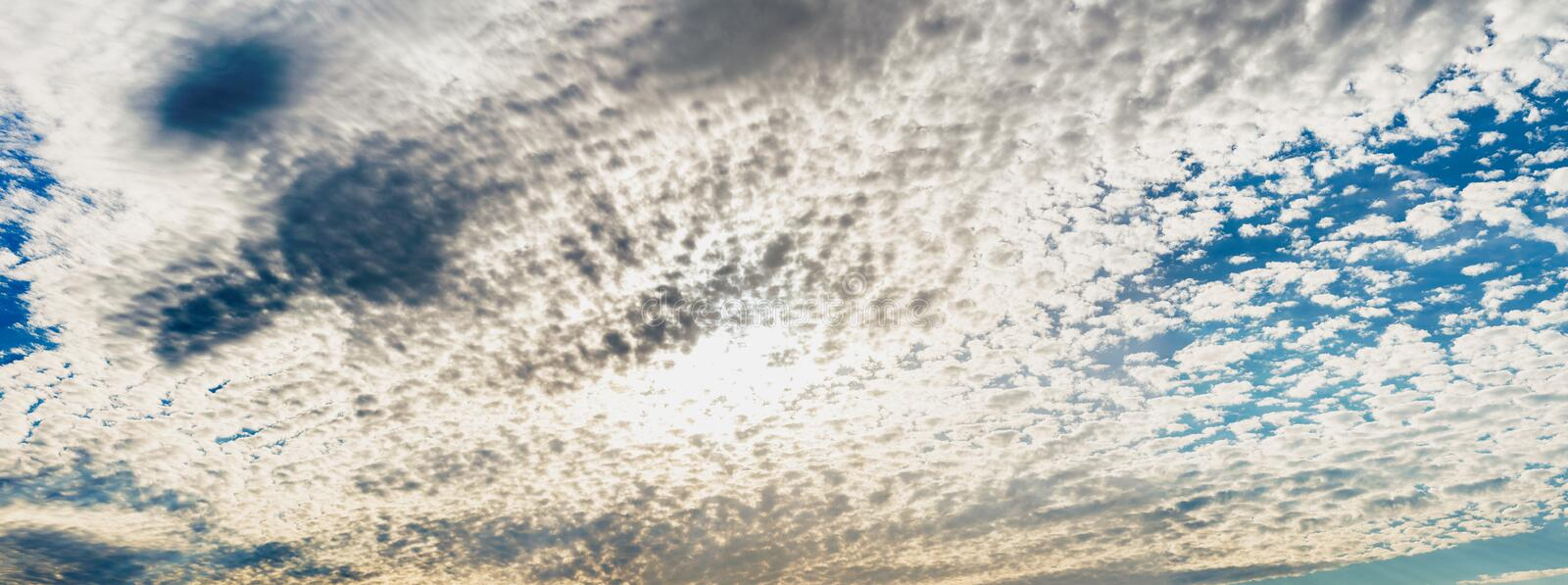Panoramic view of small clouds in the blue sky.  stock photos