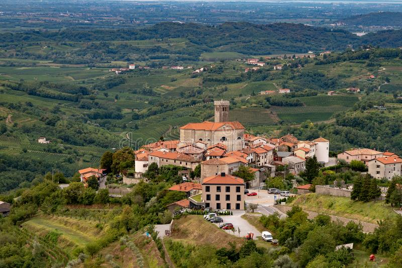 Panoramic view of Smartno in Gorska Brda, Slovenia from above with surrounding vineyards. Olive plantations and orchards stock photos