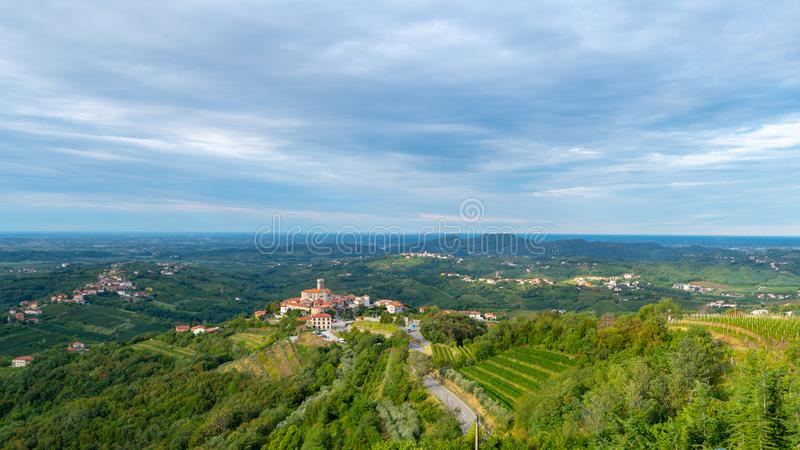 Panoramic view of Smartno in Gorska Brda, Slovenia from above with surrounding vineyards. Olive plantations and orchards stock photo
