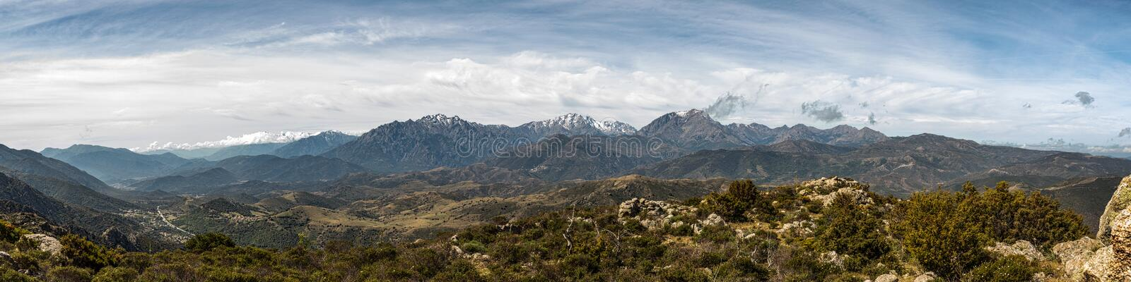 Panoramic view of snow capped mountains of northern Corsica royalty free stock photography