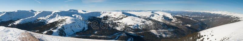 Panoramic view of snow mountains stock image
