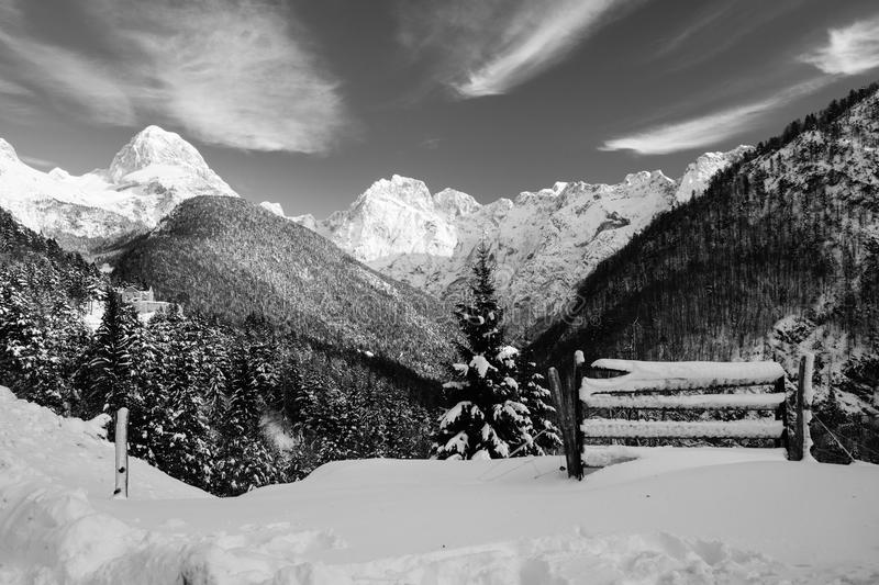 Panoramic view on snowy julian alps in winter in black and white, Slovenia royalty free stock photo