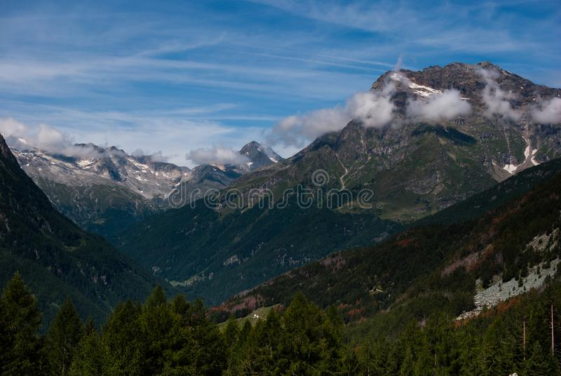 Clouds hovering the mountains royalty free stock photos