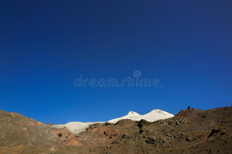 Panoramic view of the southern slope of Mount Elbrus. Of the Caucasus Mountains in Russia. Snow-covered mountain peaks with two peaks stock photography