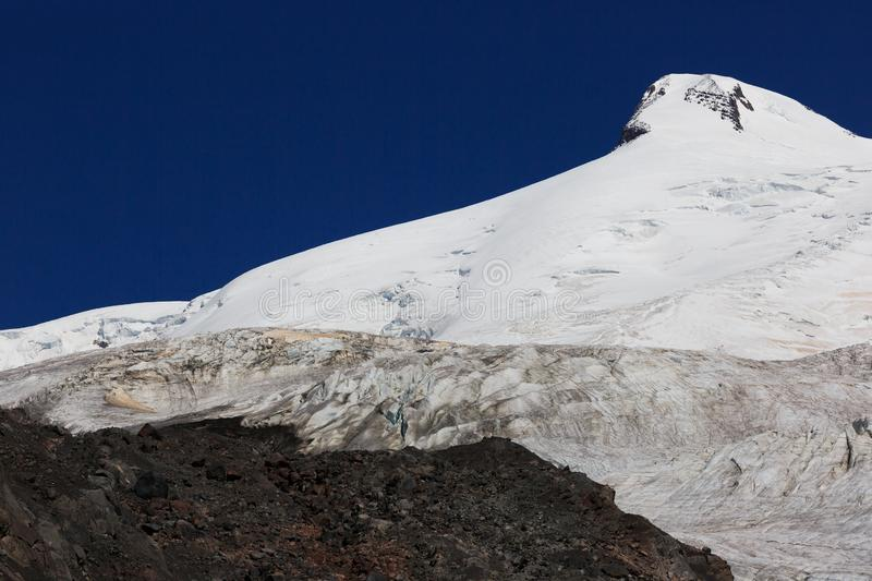 Panoramic view of the southern slope of Mount Elbrus. And the Small Azau Glacier of the Caucasus Mountains in Russia. Snow-covered mountain two peaks stock photo