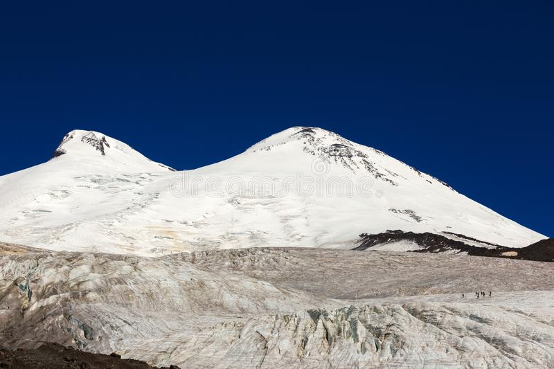 Panoramic view of the southern slope of Mount Elbrus. And the Small Azau Glacier of the Caucasus Mountains in Russia. Snow-covered mountain two peaks royalty free stock photos