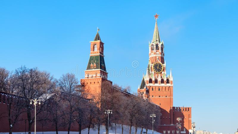 Panoramic view of towers of Kremlin wall in winter. Panoramic view of Spasskaya, Tsarskaya and Nabatnaya towers of Kremlin walls from Vasilevsky Spusk Descent of stock photos