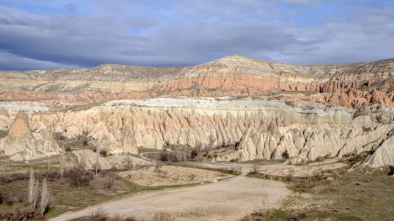 Panoramic view of the stone formations in the Red Valley of Cappadocia, Turkey stock photos