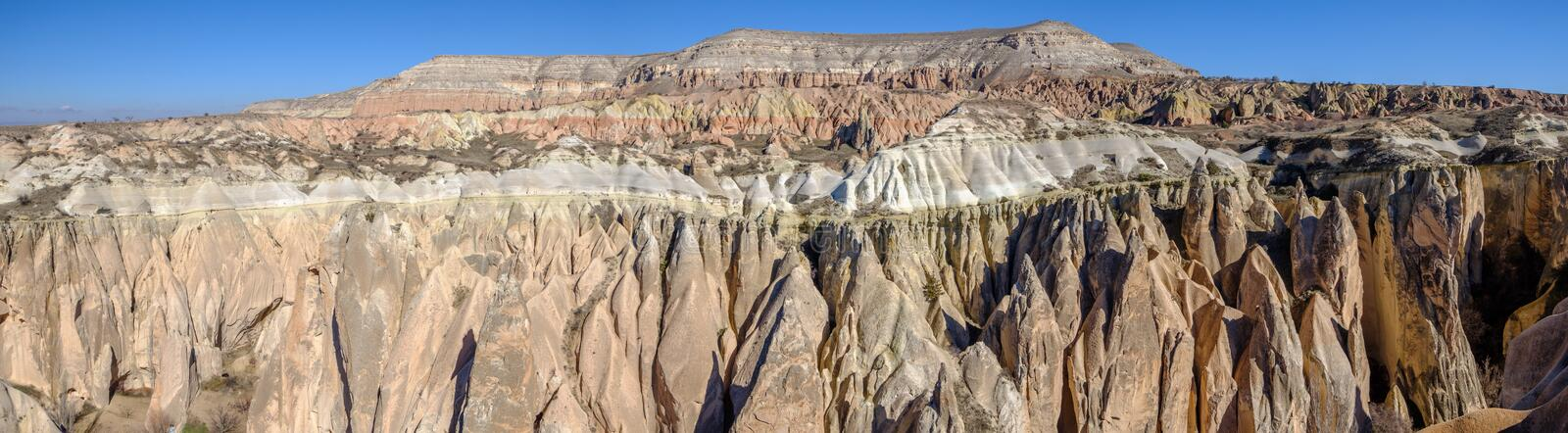 Panoramic view of the stone formations in the Red Valley of Cappadocia, Turkey stock images