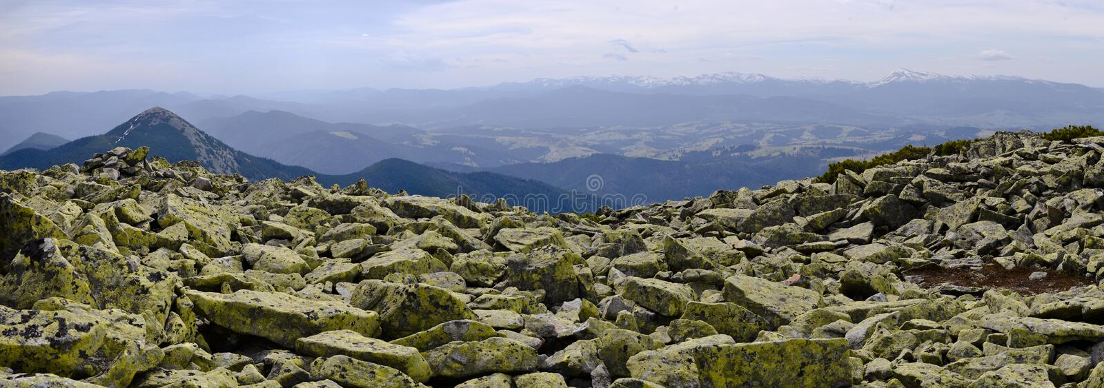 Panoramic view from a stone mountain range Gorgany to the valley royalty free stock photo