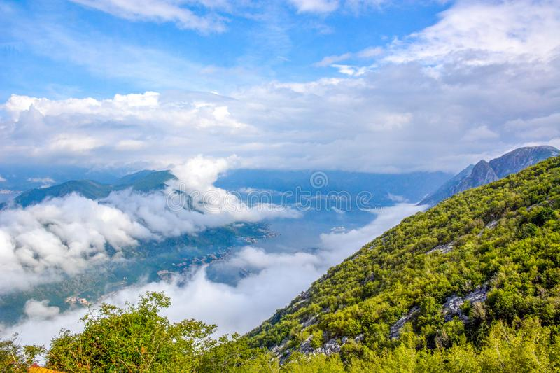 Aerial view of Kotor, Boka Kotorska Bay, Montenegro. Panoramic view from the stone top of the mountain on the gulf and houses in the city between the mountains royalty free stock photos