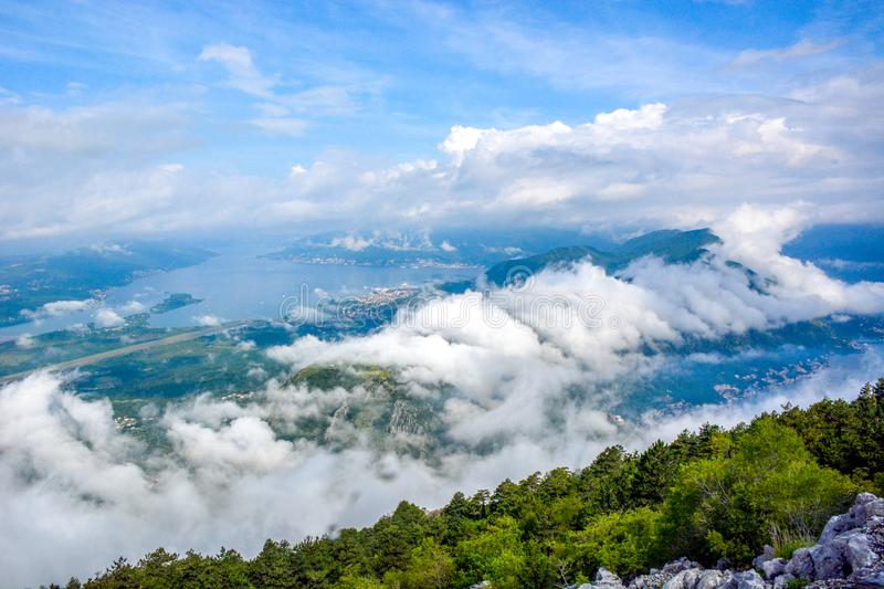 Aerial view of Kotor, Boka Kotorska Bay, Montenegro. Panoramic view from the stone top of the mountain on the gulf and houses in the city between the mountains stock photo