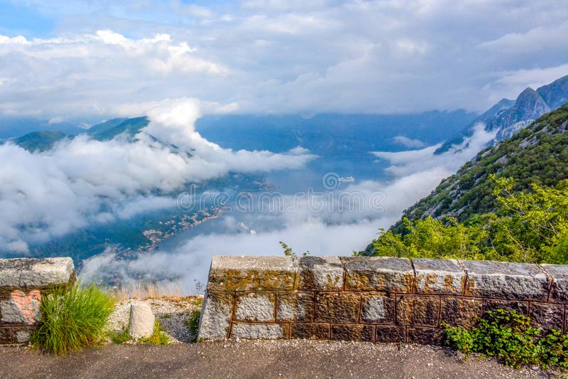 Aerial view of Kotor, Boka Kotorska Bay, Montenegro. Panoramic view from the stone top of the mountain on the gulf and houses in the city between the mountains royalty free stock image