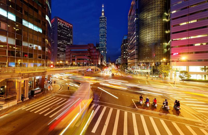 Panoramic view of a street corner in Downtown Taipei City with busy traffic trails at rush hour royalty free stock photography