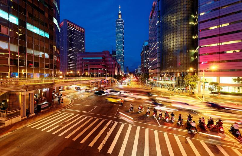Panoramic view of a street corner in Downtown Taipei City with busy traffic trails at rush hour stock image