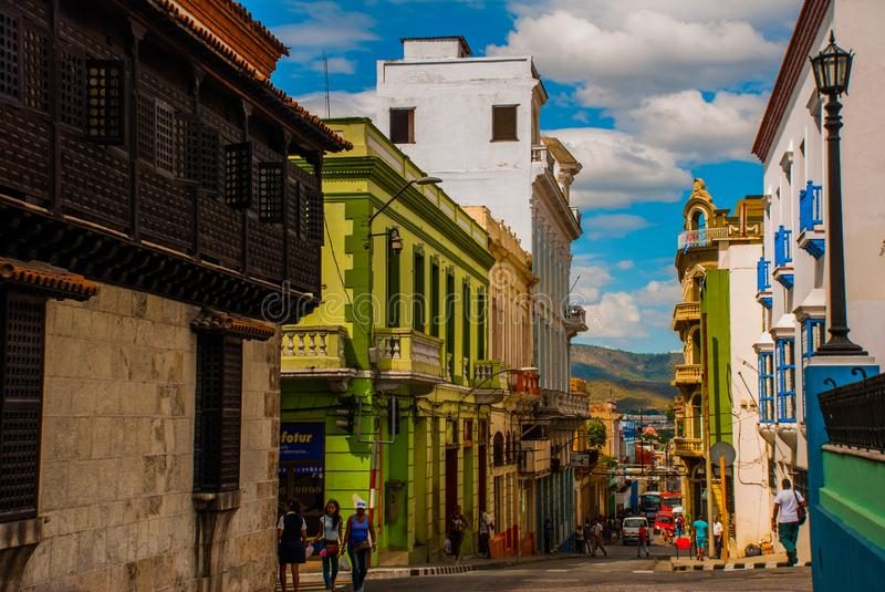 Panoramic view of street with crumbling buildings and view on a bay in Santiago de Cuba , Cuba royalty free stock images