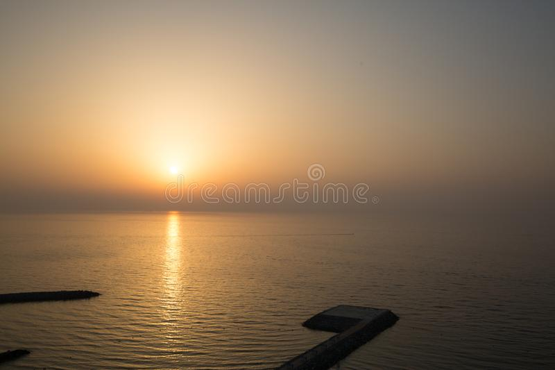 Panoramic view of sunrise and helipad landing area or platform royalty free stock photography