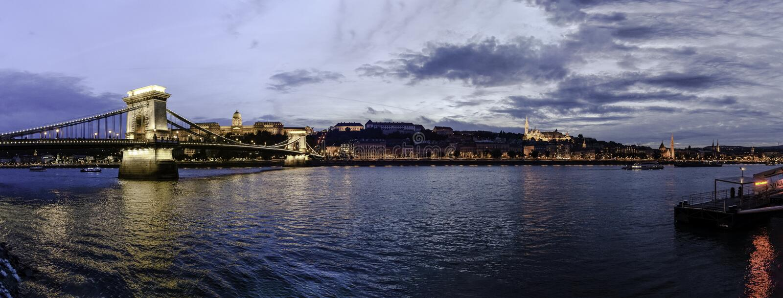 Panoramic view of the sunset from the Buda shore with Buda Castle, the Chain Bridge and the Fishermen`s Bastion, Budapest, Hungary. Panoramic view of the sunset royalty free stock photos