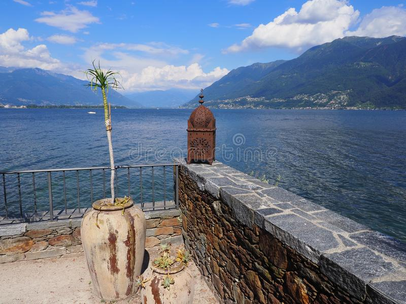Panoramic view on swiss Lake Maggiore from Brissago island near european Ascona city at alpine landscape in Switzerland royalty free stock photo
