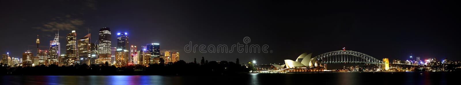 Panoramic view of the Sydney skyline, including the Harbor Bridge and Opera House at night stock images