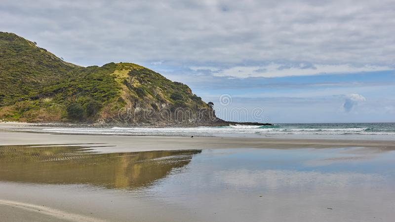 Panoramic view of Tapotupotu Beach in New Zealand. Under a cloudy sky stock photography