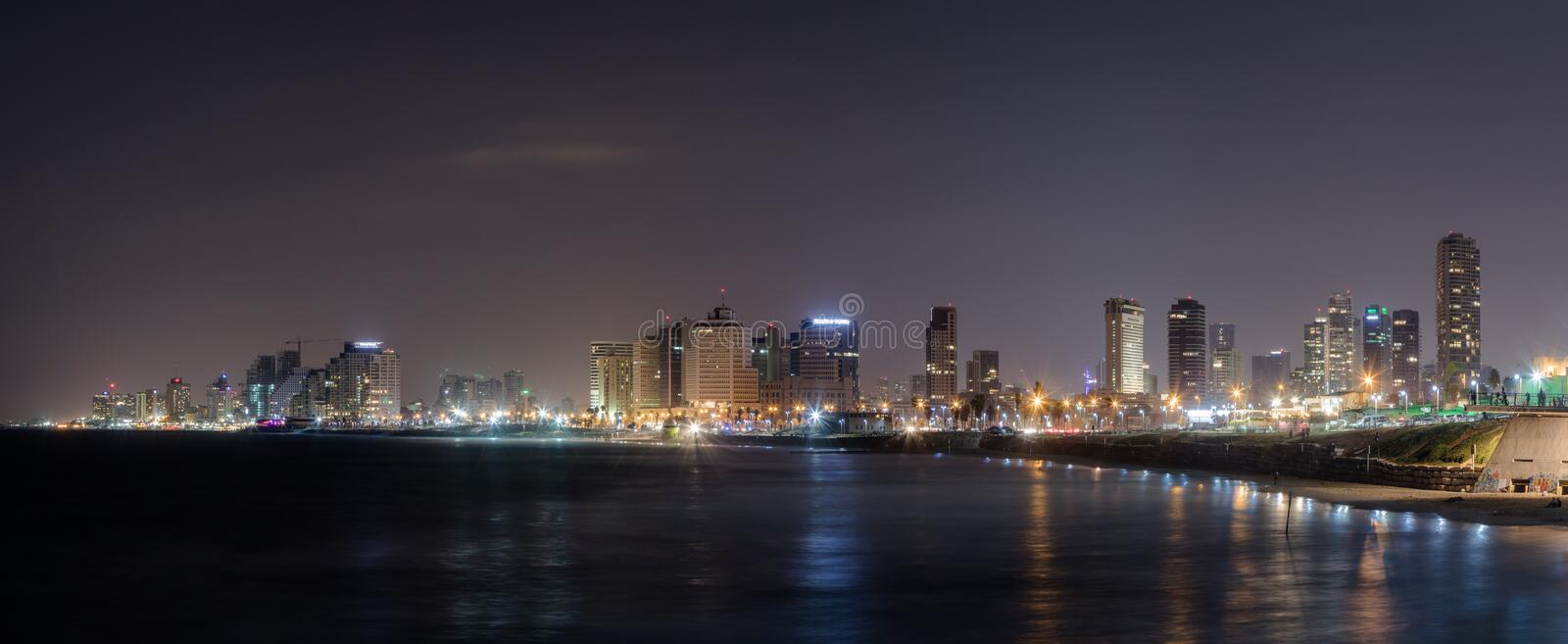 Panoramic view of Tel Aviv, city and bay at night. View from promenade of Old City Yafo, Israel stock images