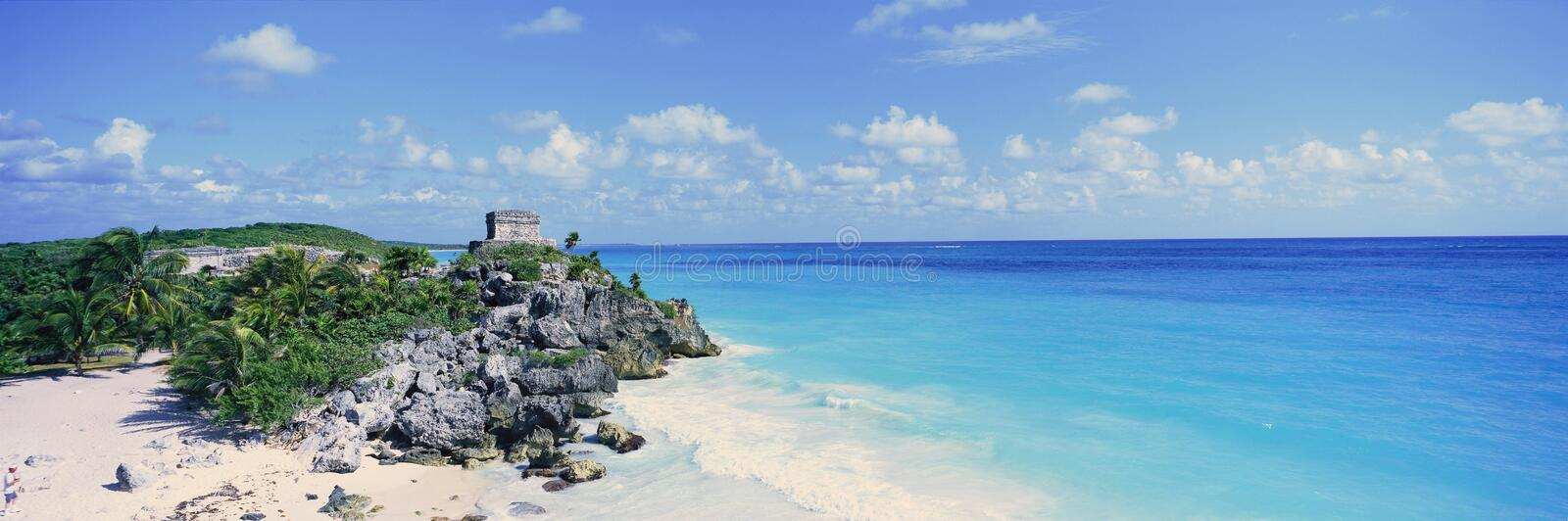 A panoramic view of the Templo del Dios del Viento Mayan ruins of Ruinas de Tulum (Tulum Ruins) in Quintana Roo, Yucatan Peninsula. Mexico stock images