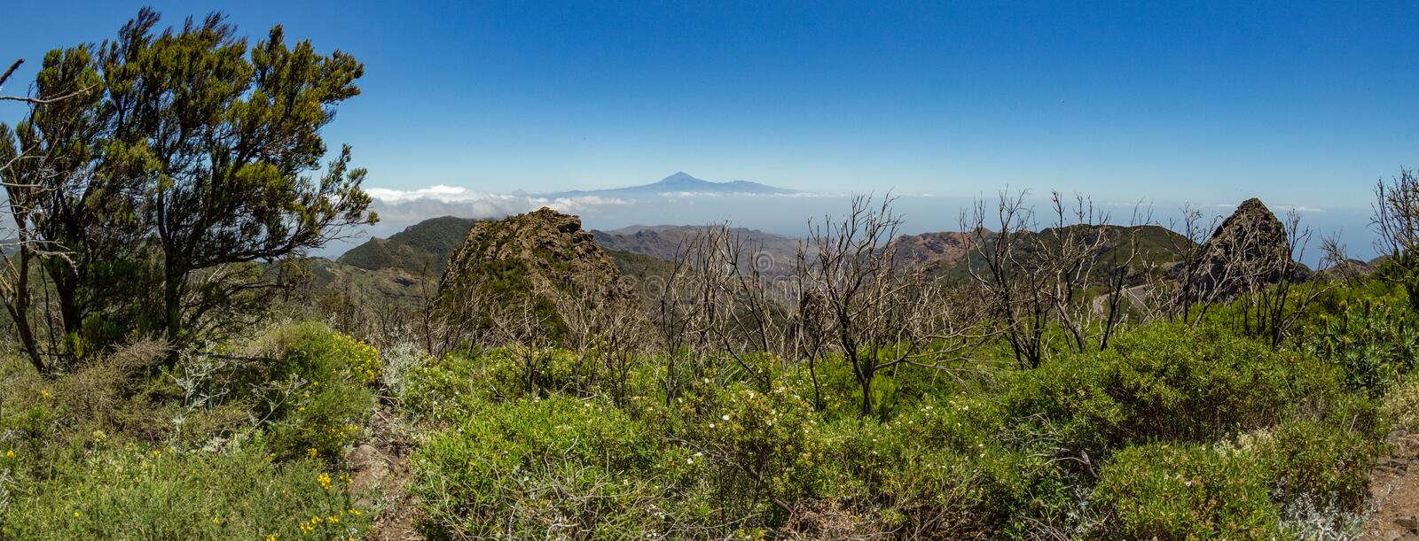 Panoramic view of Tenerife Island with volcano Teide above horizon and Los Roques peaks near Garajonay national park at La Gomera stock photos
