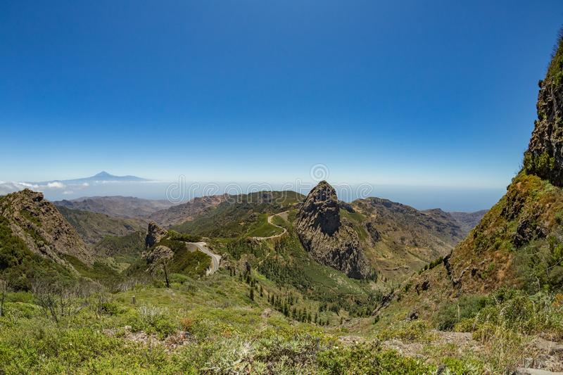 Panoramic view of Tenerife Island with volcano Teide above horizon and Los Roques peaks near Garajonay national park at La Gomera royalty free stock photo
