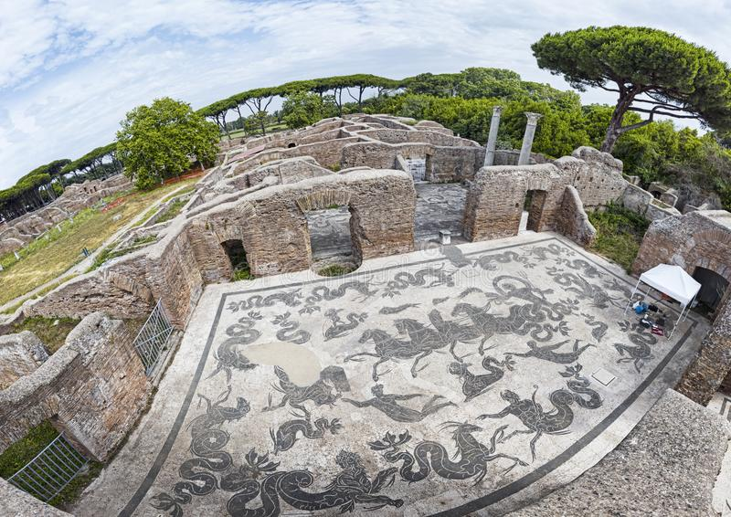Panoramic view of the thermal baths of Neptune in the archaeological excavations of Ostia Antica with the famous mosaic depicting. The Triumph of Neptune with royalty free stock photography