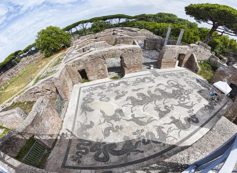 Panoramic view of the thermal baths of Neptune in the archaeological excavations of Ostia Antica with the famous mosaic depicting. The Triumph of Neptune with royalty free stock photo
