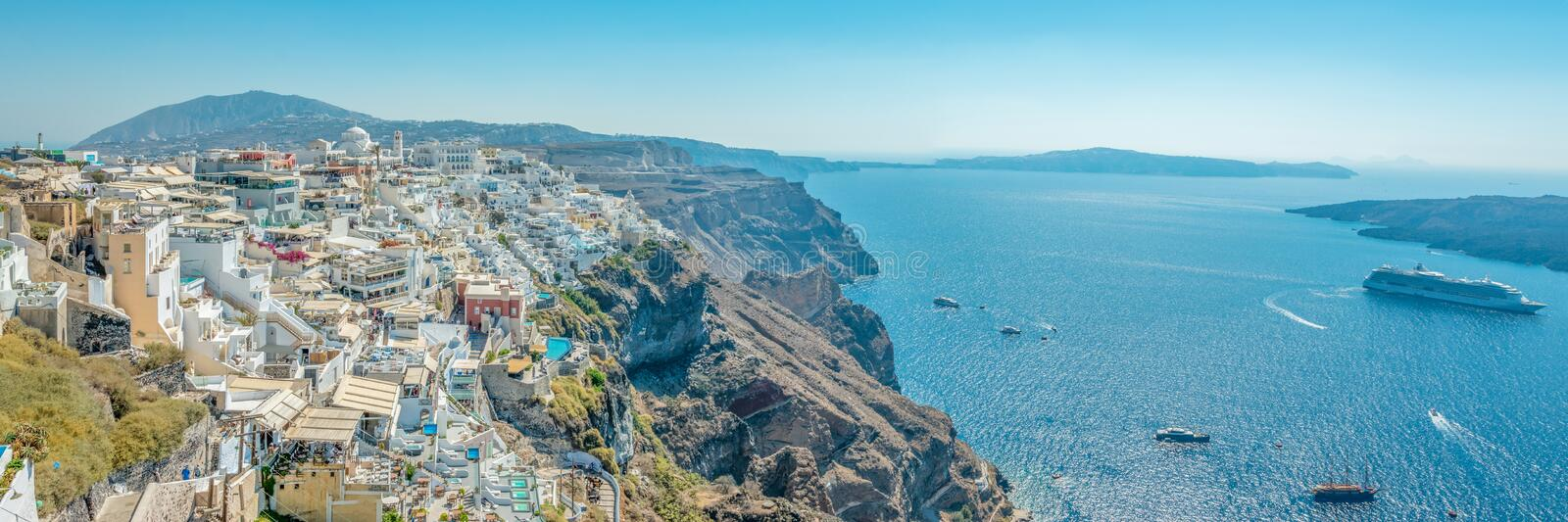 Panoramic view of Thira town with traditional and famous houses and churches with blue domes over the Caldera on Santorini island. royalty free stock photos