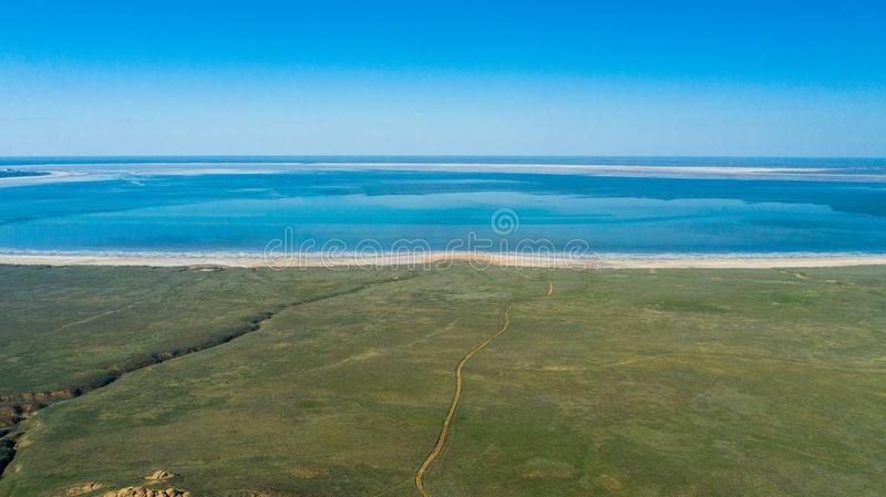 Panoramic view to Baskunchak Salt Lake and steppe from the red mount Bogdo in Astrakhan State in Russia. royalty free stock photography